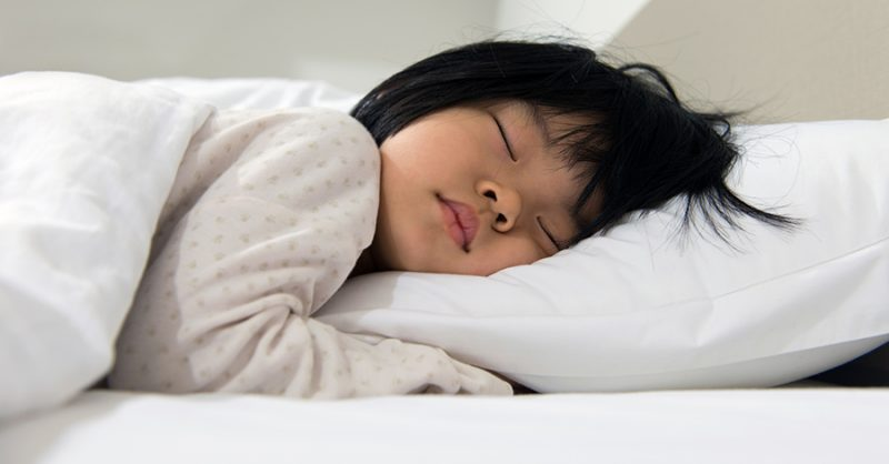 Little girl sleeping on a natural, non-toxic mattress