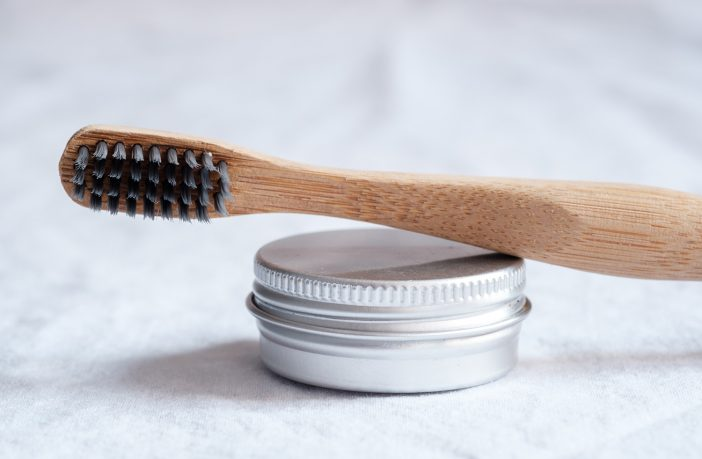 Natural toothbrush with activated charcoal bristles