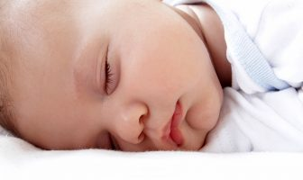 Baby sleeping on a natural crib mattress