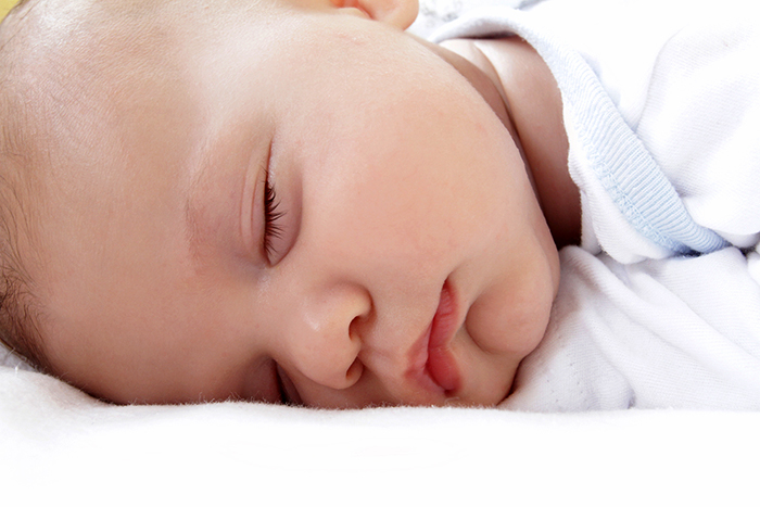 Baby sleeping on a natural crib mattress